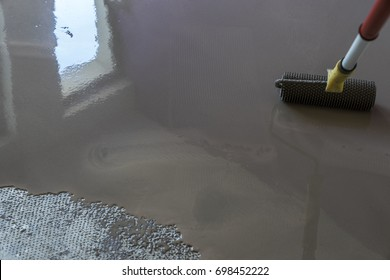 Floor covering with self leveling plaster. Mirror smooth surface of the floor. Roller application