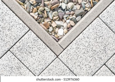 Floor design with terrace tiles and ornamental gravel; Various materials for flooring in the garden; Building materials for gardening; Professional gardening