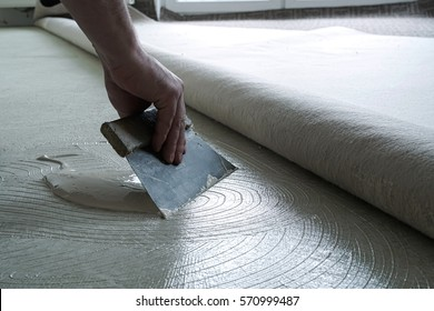 Floor Fitter when applying adhesive on the floor
