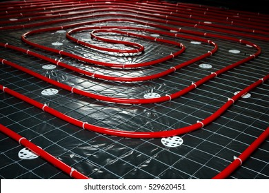 Floor heating pipe. Installation of engineering systems in a building.