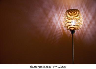 floor lite rattan lamp shine at night (peach background dark)