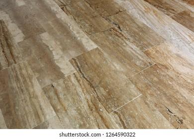a floor made of rectangular marble slabs