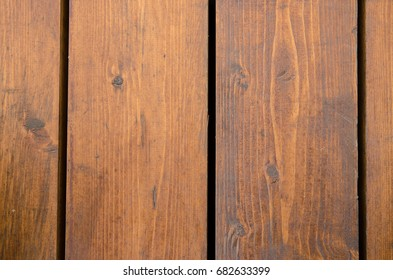 The floor is made of wooden boards with dark slits for the background. Country vintage.