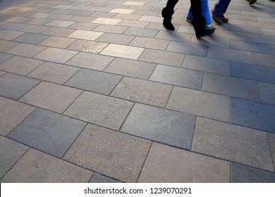 floor on the street and walking feet