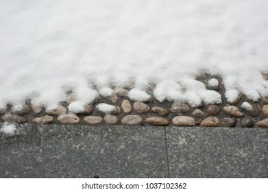 floor with pebbles and snow