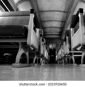 floor perspective of the aisle of a 1940s railway passenger car