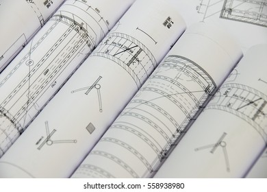 Floor plan designed building on the drawing - background. Architect rolls and plans