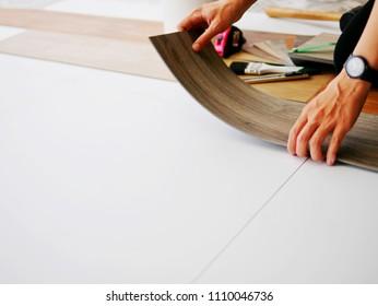 Floor renovation by installing thin vinyl sheet covering on floor tile , easy DIY working concept