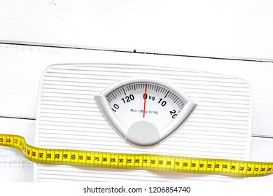 floor scale and centimeter to measure wooden background top view