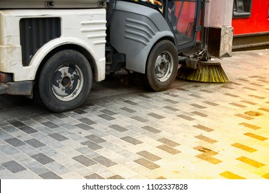 Floor scrubber sweeper is scrubbing the floor in the public area.