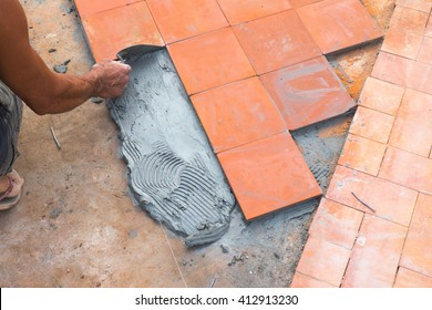 floor tile for foot path installation. Outdoor construction site