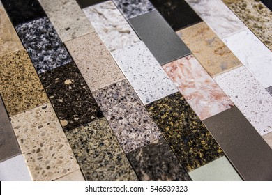 Floor tile samples made from granite, marble and quartz natural stone slabs