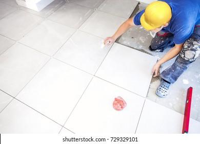 Floor tiles and Construction worker