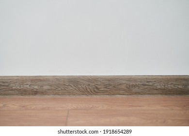 Floor with white wall and skirting board . High quality photo