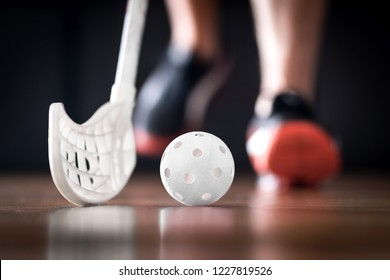 Floorball player running with ball and stick. Floor hockey concept.