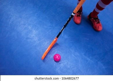 Floorball player with stick and ball. Above view