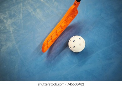 Floorball stick and ball. Focused to ball