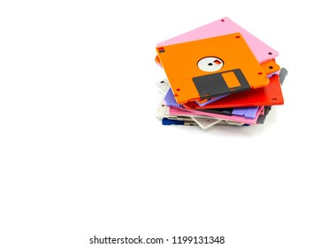 A floppy disk also called a floppy, diskette, or just disk was a ubiquitous form of data storage and exchange from the mid-1970s into the mid-2000s. isolated white background, copy space