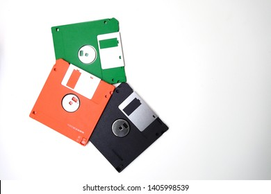 Floppy disk on white background.Floppy disk, green, orange, black