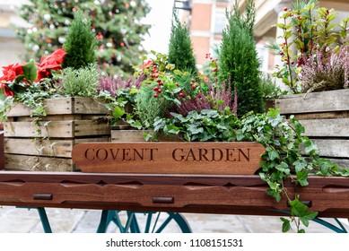 Flora filled cart, advertising London's famous old Flower Market, Covent Garden.