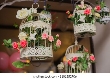 floral arrangement of flowers, bird cage with flowers