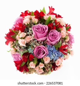 Floral arrangement made of Roses, Hydrangea, miniature Roses and Alstroemeria flowers seen from above.