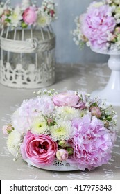 Floral arrangement with pink peonies, tiny roses, chrysanthemums and gypsophila paniculata twigs