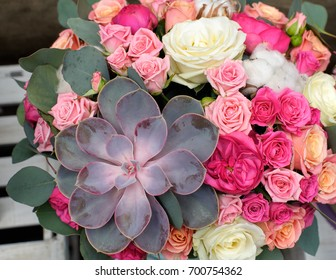 Floral arrangement of succulent and roses, flower texture background, floristic art.