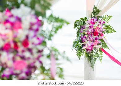 Floral arrangement at a wedding ceremony on beach.