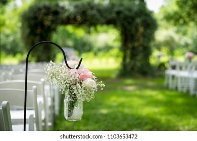 Floral arrangements at an outdoor summer wedding.