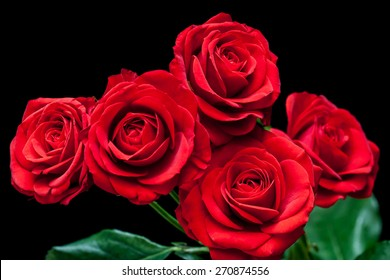 Floral background, bouquet of beautiful ruby red roses on black.  Wallpaper, greeting card