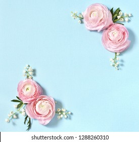 Floral background delicate. of pink Ranunculus and lily of the valley on a blue background. Romantic background for wedding invitations and greeting cards. place for text. copy space. Flatlay