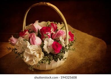 Floral basket with vintage texture effect