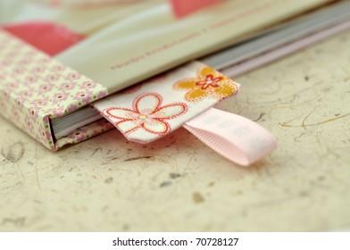 Floral bookmark in a closed book