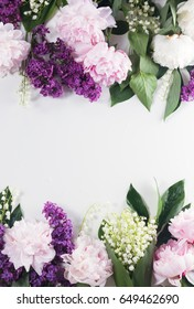 Floral borders of fresh flowers - lilac, peonies and lilly of the valley flowers on white background with copy space