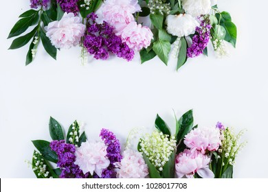 Floral borders - lilac, peonies and lilly of the walley flowers on white background, top view flat lay scene with copy space