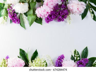 Floral borders - lilac, peonies and lilly of the walley flowers on white background with copy space