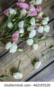 Floral bouquet of roses on a wooden background.