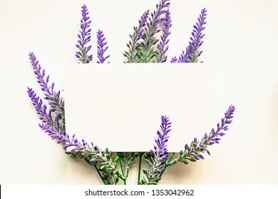 floral composition with lavander flowers and blank card, isolated on white. Greeting card mock up