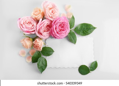 Floral composition with paper card on white background