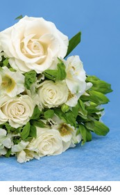 Floral composition, white roses and lily in bouquet