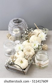 Floral decoration with white pumpkins called baby boo and chrysanthemum flowers.