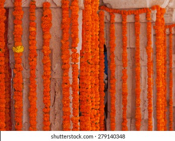 Floral decorations comprising chains of marigold flowers at a Hindu celebration in Rajasthan, India