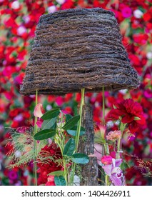 Floral decorations with a wicker walded basket.