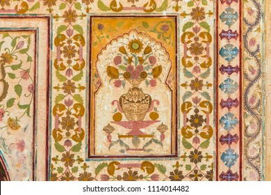 A floral design on the wall of the Ganesh Pol at Amber Fort in Rajasthan, India.