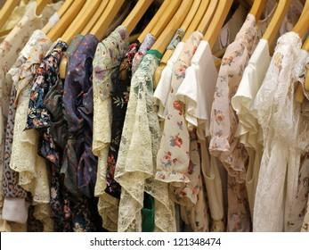 Floral design summer dresses on hangers on store rack