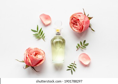 Floral flat lay with perfume bottle, top view