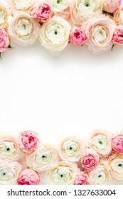 Floral frame borders made of pink ranunculus and roses flower buds on white background.  Flat lay, top view floral background.