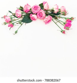 Floral frame of flowers, copy space. Spring composition with pink roses on white background. Top view. Flat lay.