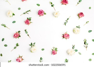 Floral frame made of red and white rose flowers and eucalyptus branches on white background. Flat lay, top view festive mockup with copy space.